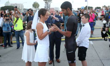 In front of friends, family, and fellow runners, Akhil Viz and Sibylle Hallstein get married at the starting line of the Jet Blue Long Beach half Marathon Sunday morning, October 7, 2018. (Photo by Tracey Roman, Contributing Photographer)